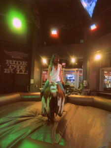 Your girl okay with a casual meal together? She can ride a bull at the Miracle Mile shops' PBR Bar & Grill.